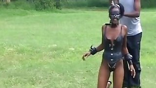 African girl gets walked like a dog image