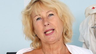 Blonde milf Greta big natural tits and uniform image