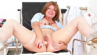 Milf brunette playing with herself in caretaker uniforms image