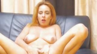 Kooky brunette masturbating on webcam image