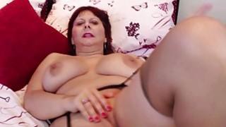 Busty_mature_lady_masturbating_in_stockings image