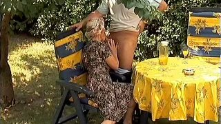 Image: Awful mature slut Paula rides and sucks a cock in the garden
