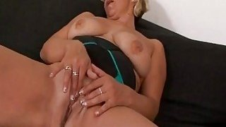 Blonde_granny_with_big_swaying_tits_enjoys_while_black_stud_stretches_her_pussy image