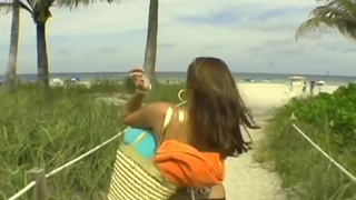 Beautiful day at the beach, with my dick in her hands image
