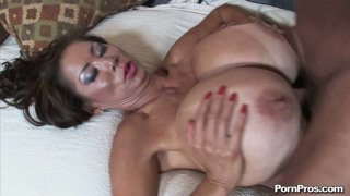 Whale Size tits of Sushi Minka giving titjob and bouncing when he pokes her missionary position image