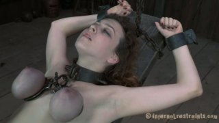 Nasty chick Dixon Mason is starring in a hardcore BDSM video produced by Infernal Restraints image