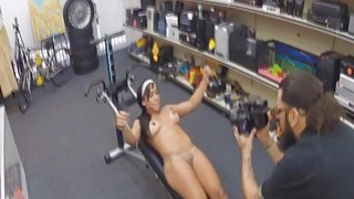 Muscle babe gets nude in pawn shop image