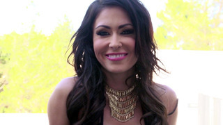 Jessica Jaymes teases the camera, stripping down to reveal her big tits image