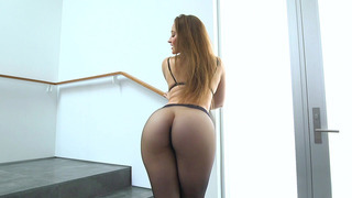 Dani Daniels posing in a sexy black pantyhose and high heels image