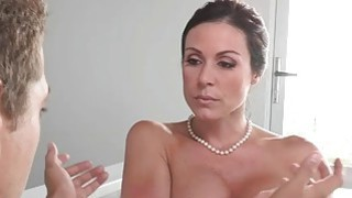 Busty milf punished her stepson and his GF with a good fuck image