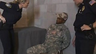Three horny police officers suck and fuck with a black cocked solider image