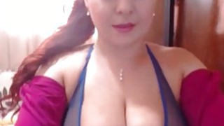 Redhead milf with incredible tits toying_pussy on webcam image