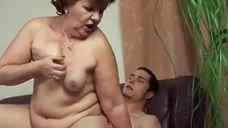 Fat granny and her young boyfriend enjoying sex image