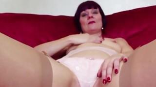 Redhead_mature_masturbating_in_stockings image