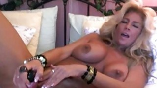 Busty Good Looking Milf Solo Masturbating image