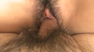 Pretty Japanese babe Momo Jyuna sucks a dick and gets pinned in a missionary position image