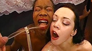Man is feeding jizz flow into babes lusty mouths image