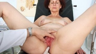 Old Ivana mature pussy speculum gyno image