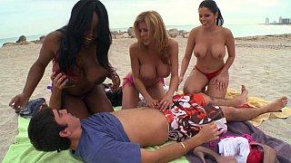 Beach MILFs seduce a young_guy image