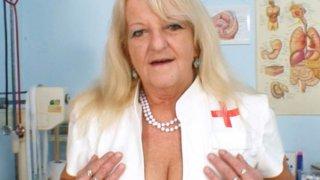 Grandma in uniform spreads blond hairy pussy image