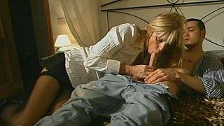 Blonde step-mom in stockings seducing son image