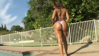 Bootylicious nympho Mya G poses naked near the pool and wins a strong dick image