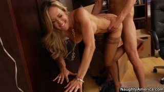 Stunning blonde in stockings Brandi Love gives away her cunt for experimentations image