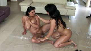 Two hottest chicks in the porn_industry Jasmine Black and_Amanda Black are rubbing each other's bodies with oil image