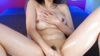 Slutty Saki Aoyama uses fingers and oil to make herself cum image