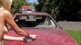 Demolition derby with sexy badass babes and gun shooting image