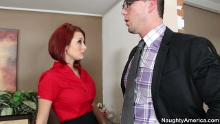Slutty red haired secretary Jessica Robbin gives a blowjob to the cock of her boss image