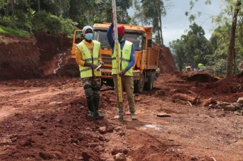 Residents move relatives' graves to make way for roads projects