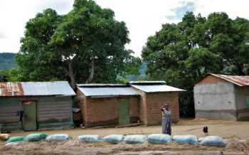 Agony for residents as floods deposit sand in homes, farms