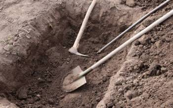 County begins burials in mass graves as more bodies disposed