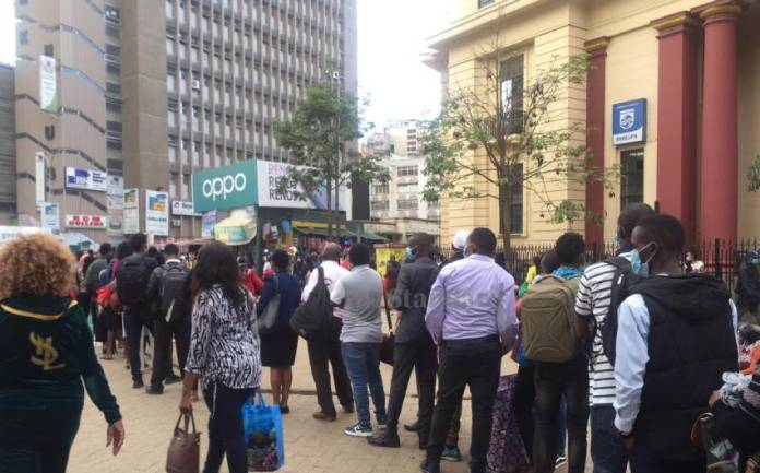 Wronfk8Whazq4G607Da6C4A894C Long Queues Outside National Archives As Commuters Race To Beat Curfew
