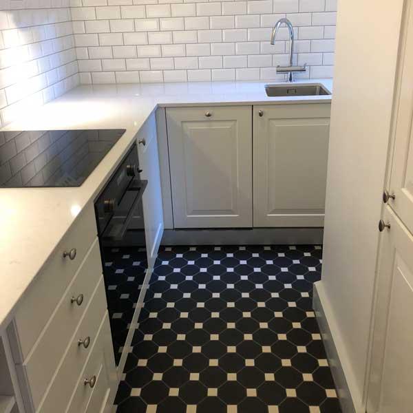 kitchen with black octagon floor tiles