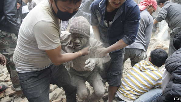 A man is pulled from the rubble in Kathmandu