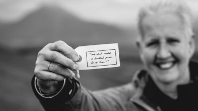 A man holding a paper with a slogan