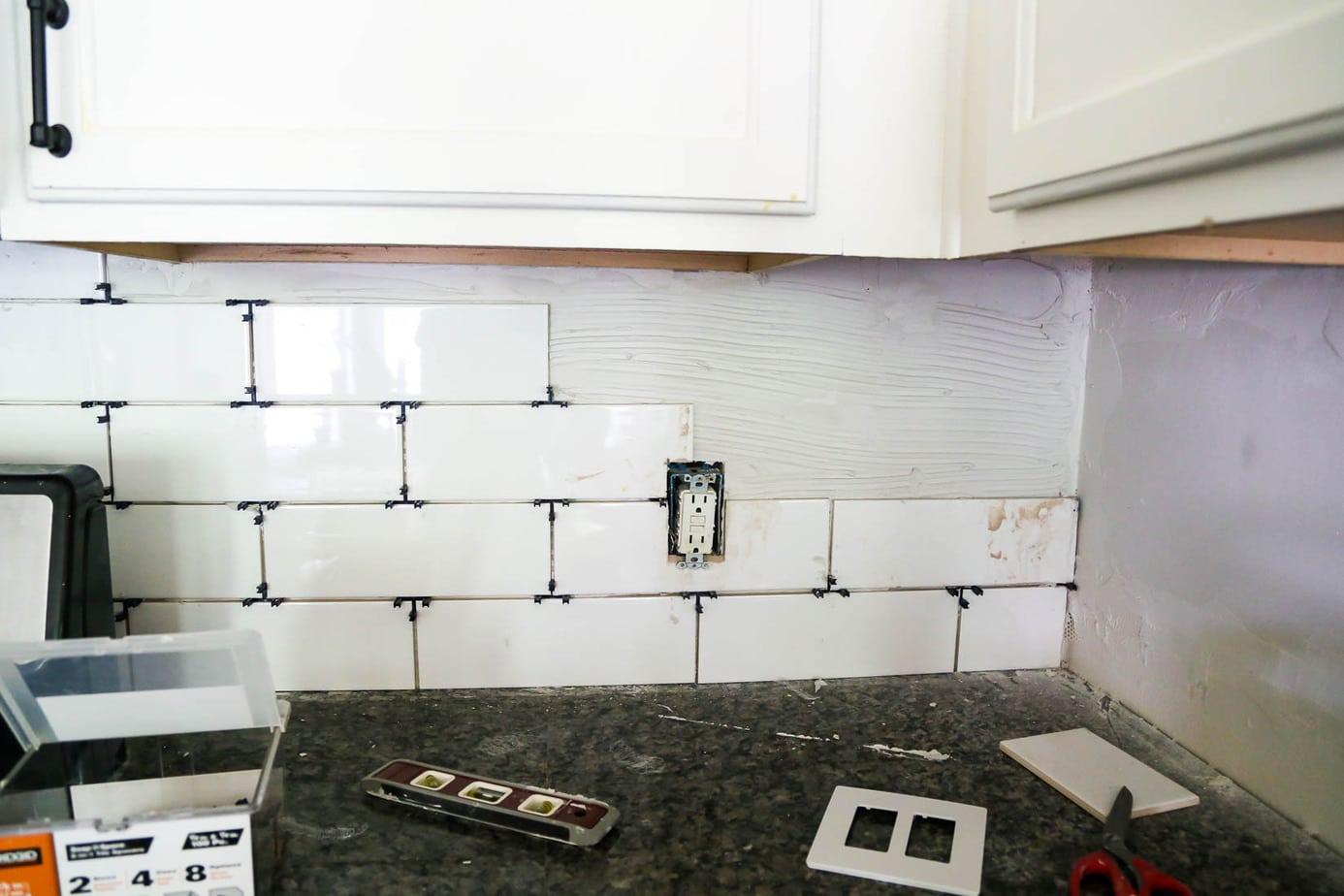how to install a subway tile backsplash