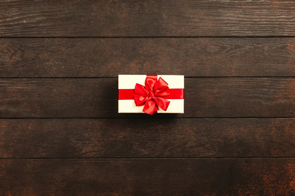 gift box Christmas present celebration holiday seasonal background wooden old table abstract top view flat lay open closed ribbon wrapping