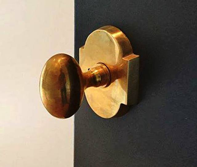 Arched Rosette With Egg Knob In Unlacquered Brass