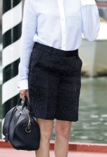 Sofia Coppola Cute Outfits - city shorts, white top, black handbag