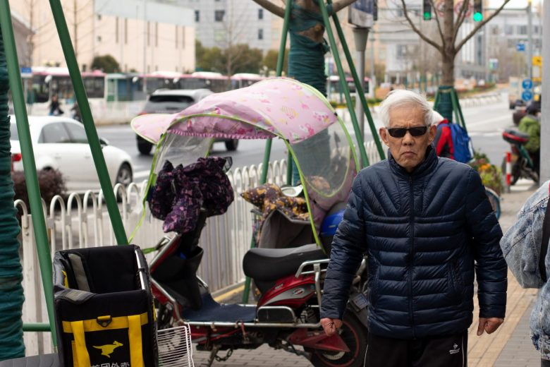 A man takes a morning walk in Shanghai March 22, 2019. (Image credit: TechNode/Cassidy McDonald)