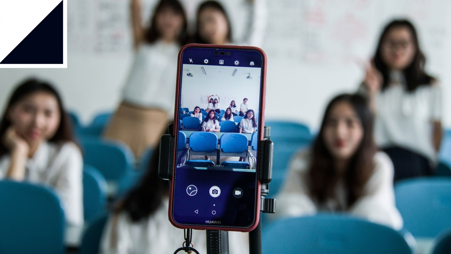Photo of girls taking photo with smartphone