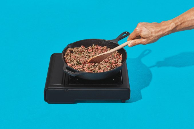 Photo of impossible burger meat being cooked in a pan