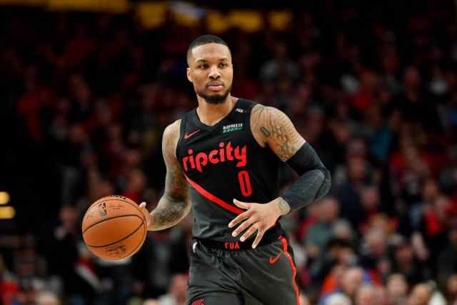On the couch with television remote, Damian Lillard has elevated ...