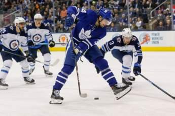 Toronto Maple Leafs forward Auston Matthews stick handling the puck between his legs.