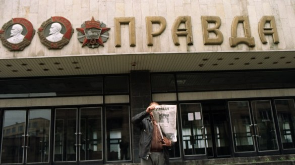 The History of Russian Involvement in America s Race Wars   The Atlantic A man shows the headline of the  Pravda  in front of the entrance of