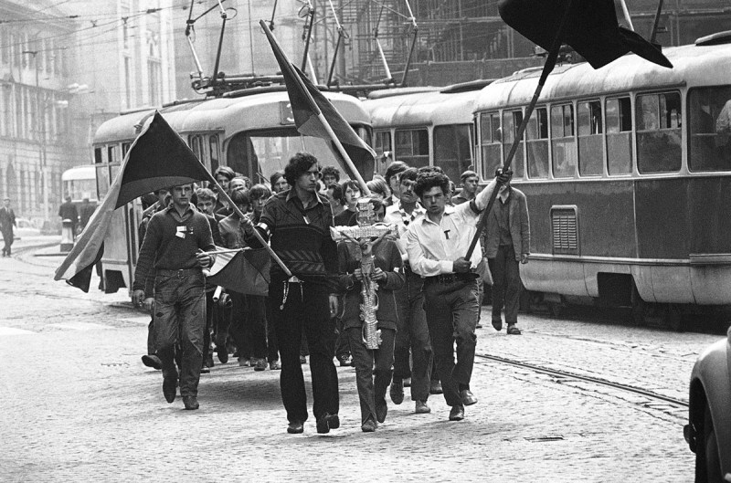 Youths carry a crucifix on their way to the burial of a friend shot by the Soviets on August 27, 1968, in Prague.