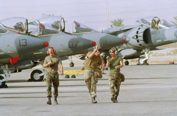 U.S. Marines walk past Marine jets at a Saudi airbase in 1990 during the Gulf War.